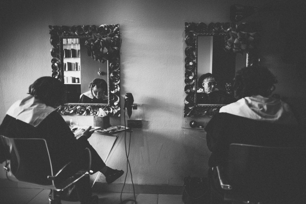 Two ladies sit in Camerini hairdressers in St Johns Hill London, photographed by Simon Hawkins Pictures