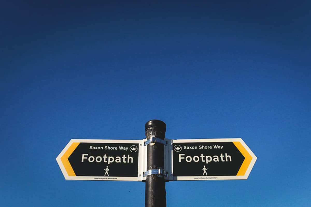 A footpath sign pointing the way to the Saxon Shore Way at Seasalter in Kent, photographed by Simon Hawkins Pictures