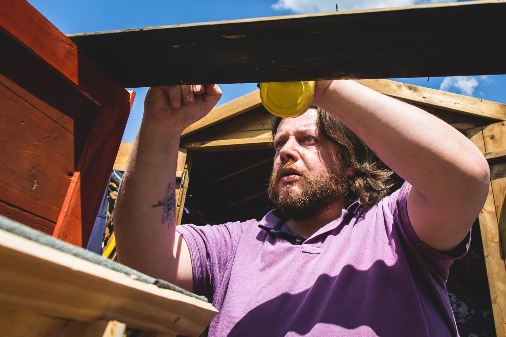 A member of the abbey physic garden building a chicken coop, photographed by Simon Hawkins Pictures in Faversham