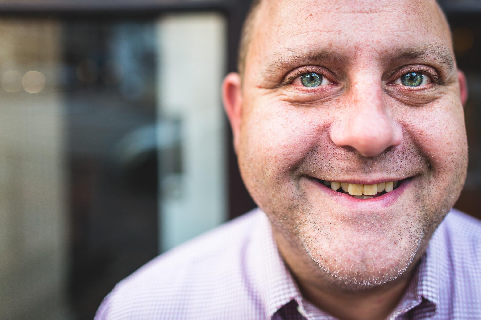A man smiles at documentary photographer Simon Hawkins in memphis USA